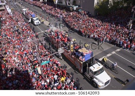 Buses filled with Philadelphia Phillies, Mayor Michael Nutter while celebrating Phillies World Series victory October 31, 2008 with parade down Broad Street Philadelphia, PA - stock photo