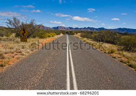 bush and road on the outback, northern territory australia - stock photo