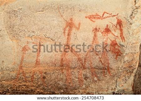 Bushmen (san) rock painting depicting human figures, Drakensberg mountains, South Africa - stock photo