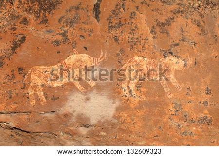 Bushmen (san) rock painting depicting rhinoceros, Drakensberg mountains, South Africa - stock photo