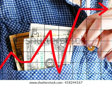 Business accounting concept. Money in cotton shirt pocket, close up - stock photo
