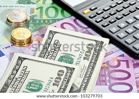 Business accounting: money and calculator - stock photo