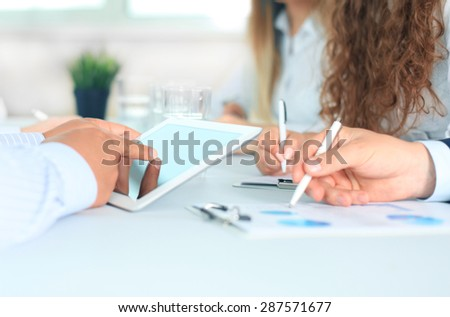 Business adviser analyzing financial figures denoting the progress in the work of the company - stock photo