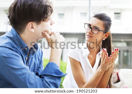 Business agent having an outdoor prep meeting with a designer before heading into a business meeting. - stock photo