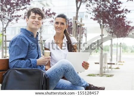 Business agent having an outdoor prep meeting with a designer before heading into a business meeting - stock photo