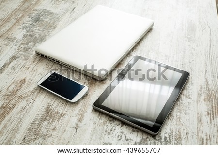 Business Analytics on a wooden Desk with a Tablet PC.  - stock photo