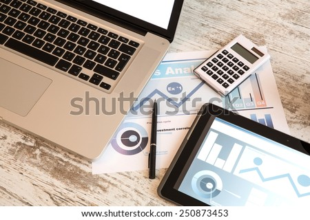 Business Analytics with a Tablet PC and a Laptop	 - stock photo