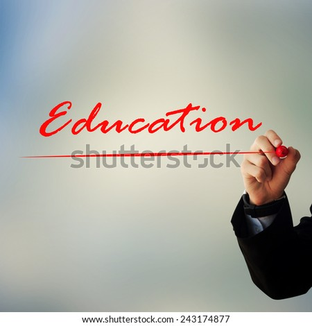 """Business and advertisement concept. Close up of businessman writing """"education"""" - stock photo"""