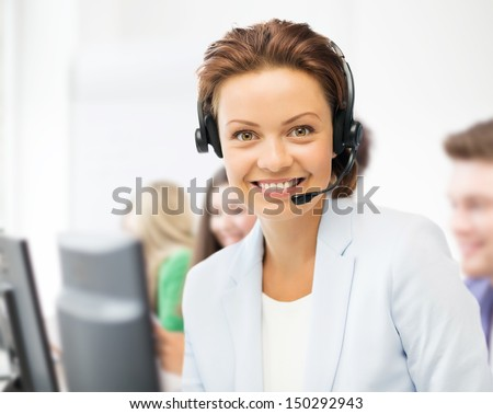 business and call center concept - helpline operator with headphones in call centre - stock photo