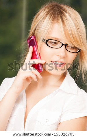 business and communication - teenage girl with cell phone calling - stock photo