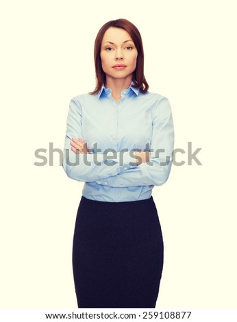 business and education concept - friendly young businesswoman with crossed arms - stock photo