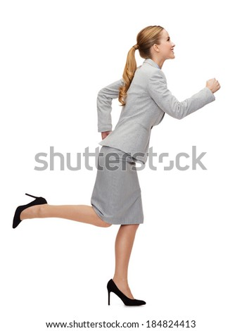 business and education concept - smiling businesswoman running - stock photo