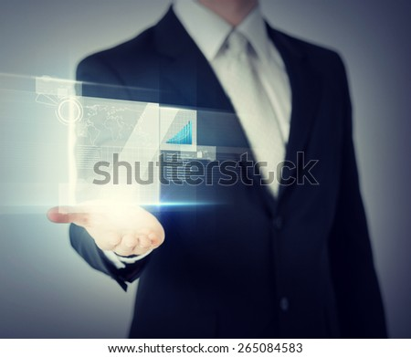 business and finances - businessman hand showing raising chart on virtual screen - stock photo