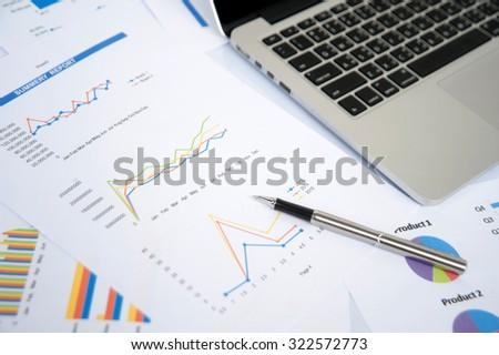 Business and marketing statistic with money graph - stock photo
