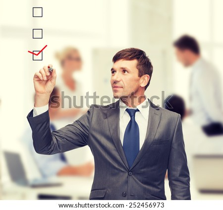 business and office concept - attractive buisnessman or teacher with marker - stock photo