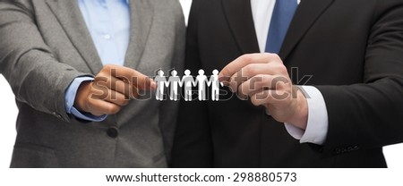 business and office concept - businessman and businesswoman holding paper team - stock photo