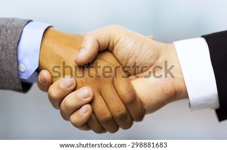 business and office concept - businessman and businesswoman showing shaking hands in office - stock photo