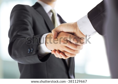 business and office concept - businessman shaking hands each oth - stock photo