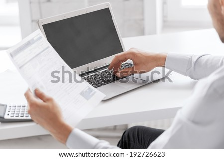 business and office concept - businessman working in office - stock photo