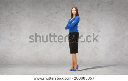 business and office concept - friendly young smiling businesswoman - stock photo