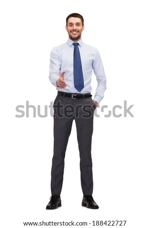 business and office concept - handsome buisnessman with open hand ready for handshake - stock photo