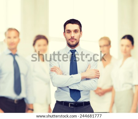 business and office concept - handsome businessman with crossed arms - stock photo