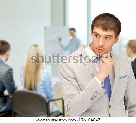 business and office concept - pensive man at office - stock photo