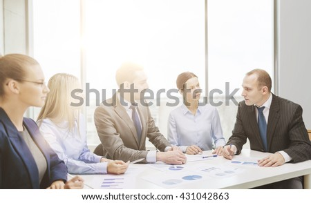 business and office concept - smiling business team at meeting - stock photo