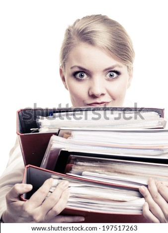 Business and paperwork. Tired overworked busy businesswoman carrying stack of folders with files documents isolated on white. - stock photo