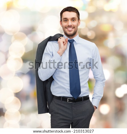 business and people concept - smiling young and handsome businessman - stock photo
