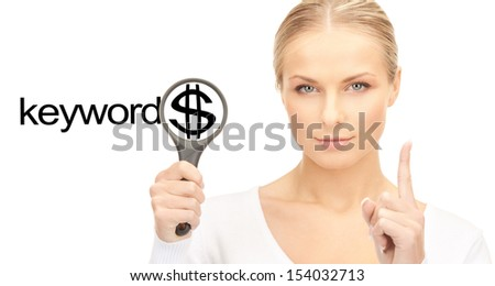 business and seo concept - woman with magnifying glass and keywords word - stock photo
