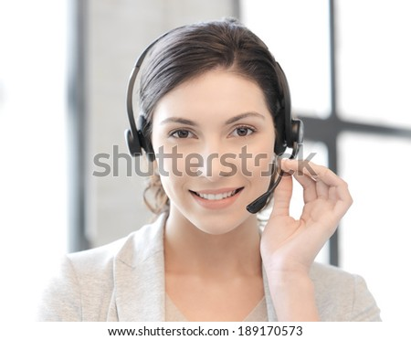 business and technology concept - friendly female helpline operator - stock photo