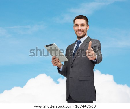 business and technology concept - smiling businessman with tablet pc computer - stock photo