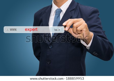 Business and technology, searching system and internet concept - male hand pressing Search expert button.  - stock photo
