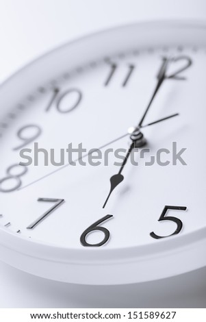 business and time concept - white clock showing six o'clock - stock photo