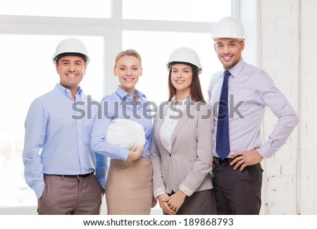 business, architecture and office concept - happy team of architects in office - stock photo