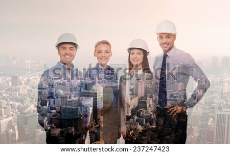 business, architecture, development and people concept - happy team in white hardhats over transparent city background - stock photo