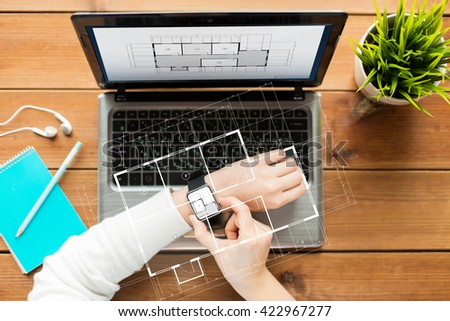 business, architecture, people and technology concept - close up of woman with smart watch and laptop computer on wooden table with blueprint projection - stock photo