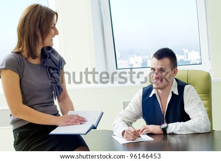Business assistant with boss in office interior - stock photo