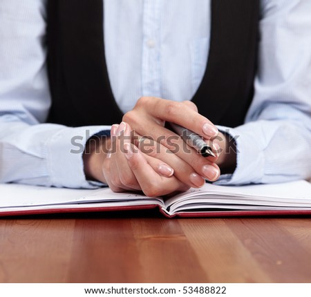 Business Attitude. Close-up for Businesswoman Hands with pen and organizer - stock photo