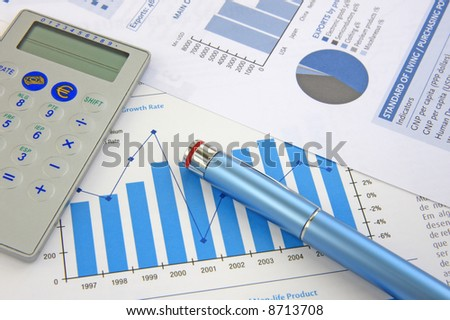 Business Background: Financial report, pen and Calculator - stock photo