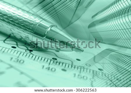 Business background in greens with graph, buildings and pen. - stock photo