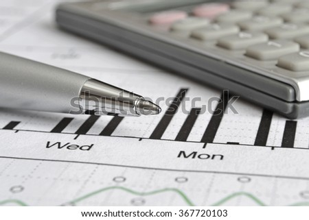 Business background with graph, pen and calculator. - stock photo