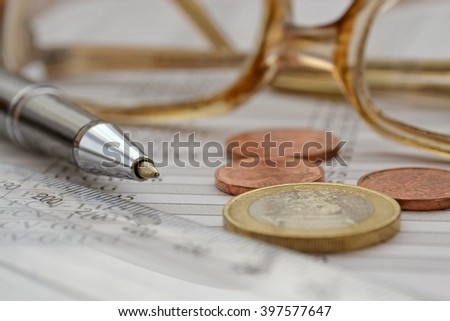 Business background with money, table, ruler, pen and glasses. - stock photo