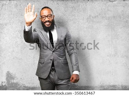 business black man greeting gesture - stock photo