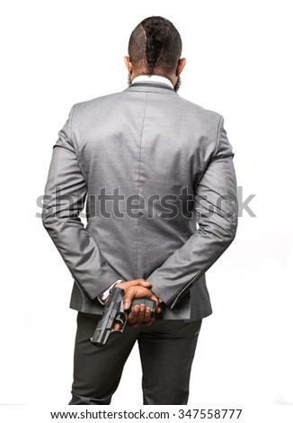 business black man holding a gun - stock photo