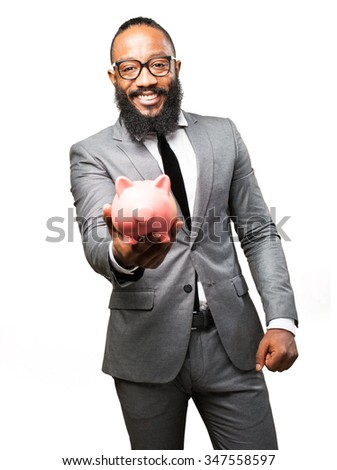business black man saving with a piggy bank - stock photo