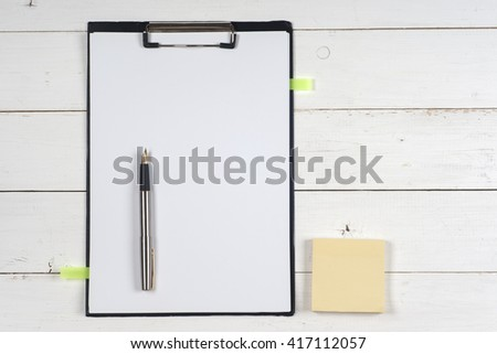 Business blank, notepad,  and pen at office desk table top view. Corporate stationery branding mock-up.  Copy space for text. - stock photo