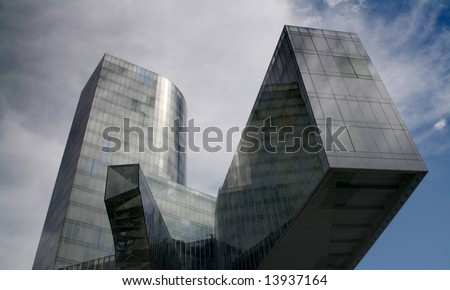 Business building, blue glass, clouded sky background - stock photo