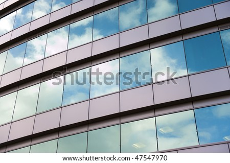 Business building windows and sky reflection. - stock photo